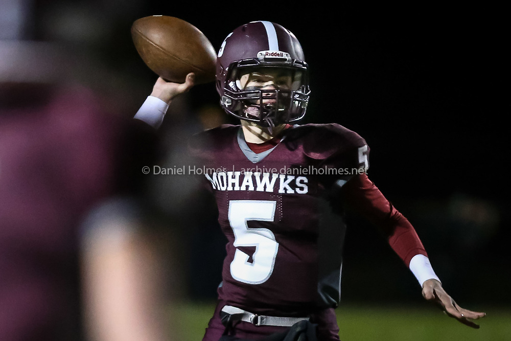 (11/11/16, MILLIS, MA) Millis-Hopedale quarterback Bryce Latosek connects with an open receiver during the playoff game against St. John Paul II at Millis High School on Friday. Daily News and Wicked Local Photo/Dan Holmes