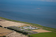 Nederland, Groningen, Gemeente Delfzijl, 08-09-2009; winplaats voor aardgas aan de Waddenzee (ten Westen van Delfzijl)..Station natural gas on the coast of the Wadden Sea (West of Delfzijl).luchtfoto (toeslag); aerial photo (additional fee required); .foto/photo Siebe Swart