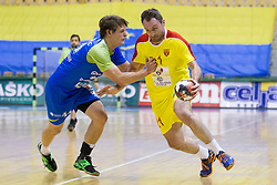 Jure Dolenc of Slovenia and Nemanja Pribak of F.Y.R. Macedonia during friendly handball match between National Teams of Slovenia and F.Y.R. of Macedonia before EHF EURO 2016 in Poland on January 5, 2016 in Arena Zlatorog, Celje, Slovenia. Photo by Urban Urbanc / Sportida