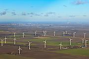 Nederland, Flevoland, Flevopolder, 20-01-2011; de windmolens op het erf bij de boerderij en in het veld vormen een windmolenpark. Lelystad aan de horizon...Wind mill park in the polder of Flevoland. The city of Lelystad at hte horizon..luchtfoto (toeslag), aerial photo (additional fee required).copyright foto/photo Siebe Swart