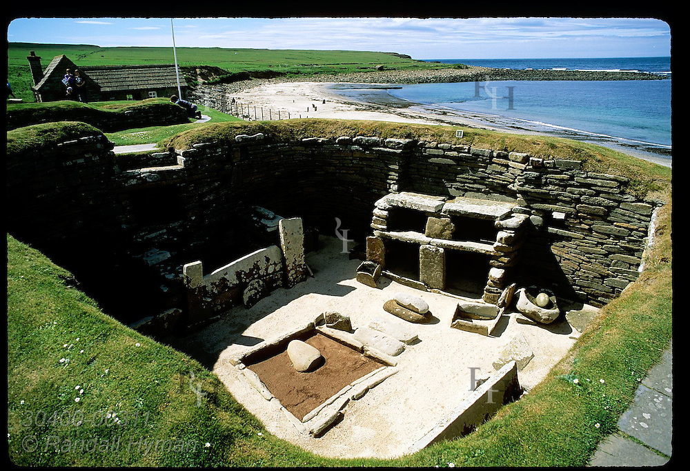 Restored double hearth and box bed are showcased in 5000-yr-old stone home at Skara Brae; Orkney Scotland