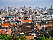 """27 NOVEMBER 2012 - BANGKOK, THAILAND: The skyline of Bangkok as seen from the top of Wat Saket during the annual temple fair. Wat Saket, popularly known as the Golden Mount or """"Phu Khao Thong,"""" is one of the most popular and oldest Buddhist temples in Bangkok. It dates to the Ayutthaya period (roughly 1350-1767 AD) and was renovated extensively when the Siamese fled Ayutthaya and established their new capitol in Bangkok. The temple holds an annual fair in November, the week of the full moon. It's one of the most popular temple fairs in Bangkok. The fair draws people from across Bangkok and spills out in the streets around the temple.    PHOTO BY JACK KURTZ"""