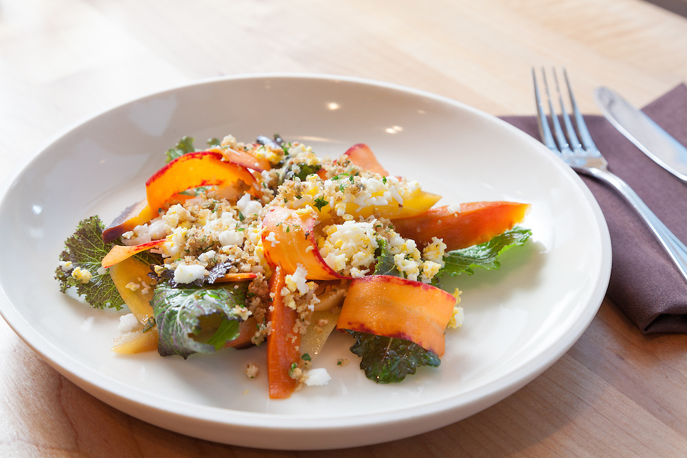 Coquine  restaurant, Portland - Chef Katy Millard<br /> - roasted and raw carrots with peppery mustard greens, caper berries, and a sieved duck egg.