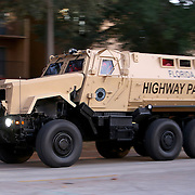 A Florida Highway Patrol armored vehicle is seen as it leaves after searching for suspect Markeith Loyd at the Tzadik Brookside Apartments on January 9 2017 in Orlando, Florida. Loyd shot an Orlando Police officer earlier in the day at a local Walmart, the officer has since died.  (Alex Menendez via AP)