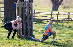 © Licensed to London News Pictures. 05/04/2020. London, UK. A couple exercise in Richmond Park. Members of the public come out to exercise as temperatures reach 21c this weekend. Richmond Park seems quieter after the Government urged the public not to leave home during the fine weather as the Coronavirus crisis continues. Photo credit: Alex Lentati/LNP