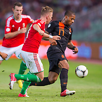 Hungary's Balazs Dzsudzsak (2nd R) and Netherlands' Jeremain Lens (R) fight for the ball during a World Cup 2014 qualifying soccer match Hungary playing against Netherlands in Budapest, Hungary on September 11, 2012. ATTILA VOLGYI
