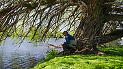 Angler Rhett Dotson searches for trout under the overhanging willows of the lower Henry's Fork--where drift boats can't go.