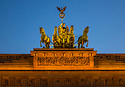 Night photo of the The Brandenburg Gate is an 18th-century neoclassical monument in Berlin.<br />