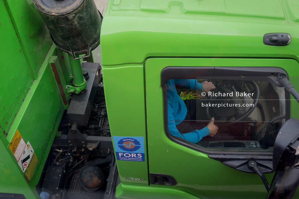 A lorry driver's arms and steering wheel of a FORS member operator, on 30th October 2017, in London, England. The Fleet Operator Recognition Scheme (FORS) is a voluntary accreditation scheme that promotes best practice for commercial vehicle operators. With over 4,700 members, FORS is gaining recognition as the transport industry's go-to accreditation scheme.