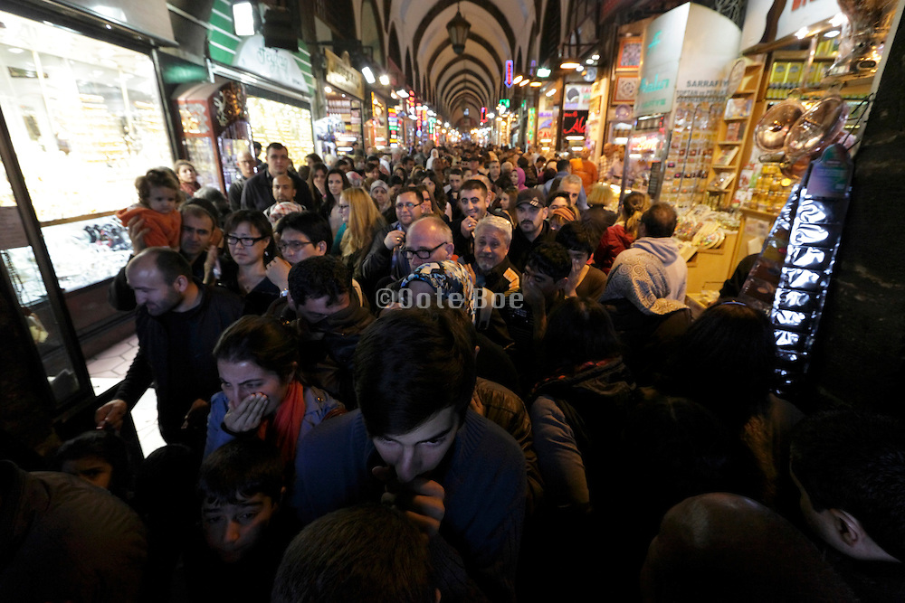 Istanbul spice bazaar with people covering there nose and mouth to prevent sneezing