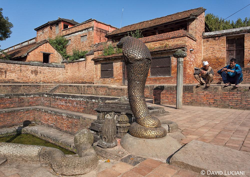 A Naga statue looking over the snake water tank of Naga Pokhari set in the royal palace at Bhaktapur's Durbar Square.