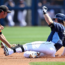 March 20, 2011; Port Charlotte, FL, USA; Tampa Bay Rays third baseman Evan Longoria (3) is tagged out by Baltimore Orioles shortstop J.J. Hardy (2) while trying to advance to second base on a hit during a spring training exhibition game at Charlotte Sports Park.  Mandatory Credit: Derick E. Hingle-US PRESSWIRE