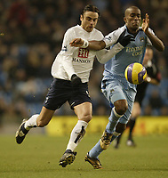 Photo: Aidan Ellis.<br /> Manchester City v Tottenham Hotspur. The Barclays Premiership. 17/12/2006.<br /> City's Sylvain Distin (R) chases the ball with Spurs Dimitar Berbatov