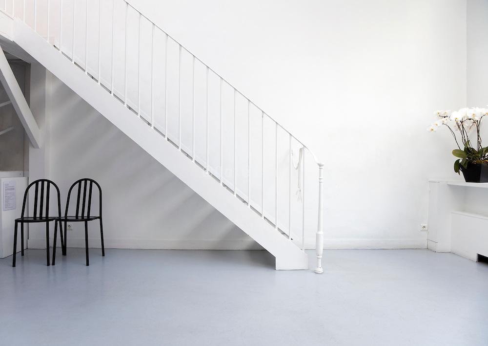 all white upper room in the Henri Cartier Bresson Foundation in Paris