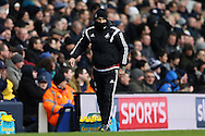 Francesco Guidolin, the Swansea City manager looks on from the touchline all wrapped up from the cold. . Barclays Premier league match, Tottenham Hotspur v Swansea city at White Hart Lane in London on Sunday 28th February 2016.<br /> pic by John Patrick Fletcher, Andrew Orchard sports photography.