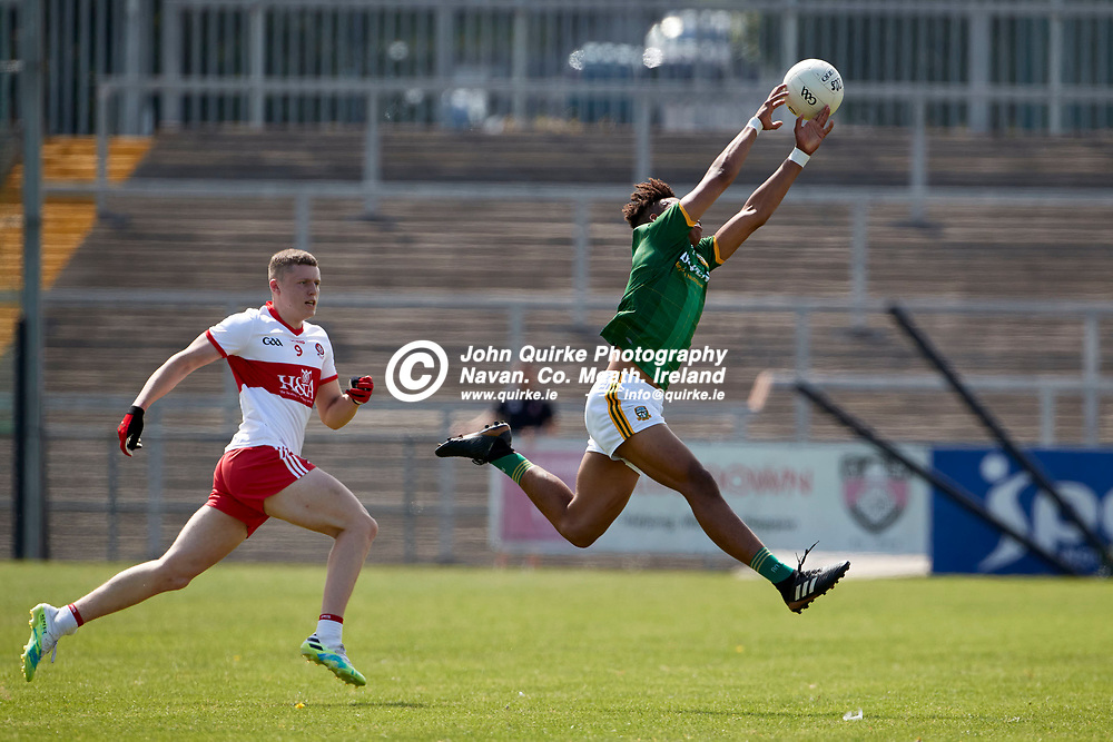 2021-7-10, 2020 All Ireland MFC Semi-Final at Pairc Esler, Newry.<br /> Meath v Derry<br /> Sean Emmanuel (Meath) and Patrick O`Kane (Derry)<br /> Photo: David Mullen / www.quirke.ie ©John Quirke Photography, Proudstown Road Navan. Co. Meath. 046-9079044 / 087-2579454.<br /> ISO: 400; Shutter: 1/1600; Aperture: 5;