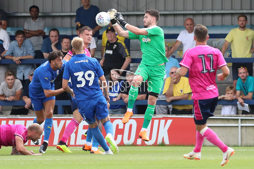 AFC Wimbledon goalkeeper Joe McDonnell (24) saving during the Pre-Season Friendly match between AFC Wimbledon and Queens Park Rangers at the Cherry Red Records Stadium, Kingston, England on 14 July 2018. Picture by Matthew Redman.