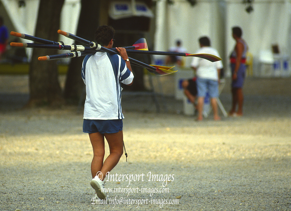 Banyoles, SPAIN, German Women's Double Sculls.. GER W2X   Gold Medalist. stroke Kathrin BORON and Kerstin KOEPPEN. THEIR COACH CARRIES THEIR SCULL BACK TO TEH RACK. 1992 Olympic Regatta, Lake Banyoles, Barcelona, SPAIN.    [Mandatory Credit: Peter Spurrier: Intersport Images]