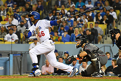May 9, 2018 - Los Angeles, CA, U.S. - LOS ANGELES, CA - MAY 09: Los Angeles Dodgers Right field Yasiel Puig (66) hits a single during a MLB game between the Arizona Diamondbacks and the Los Angeles Dodgers on May 9, 2018 at Dodger Stadium in Los Angeles, CA. (Photo by Brian Rothmuller/Icon Sportswire) (Credit Image: © Brian Rothmuller/Icon SMI via ZUMA Press)