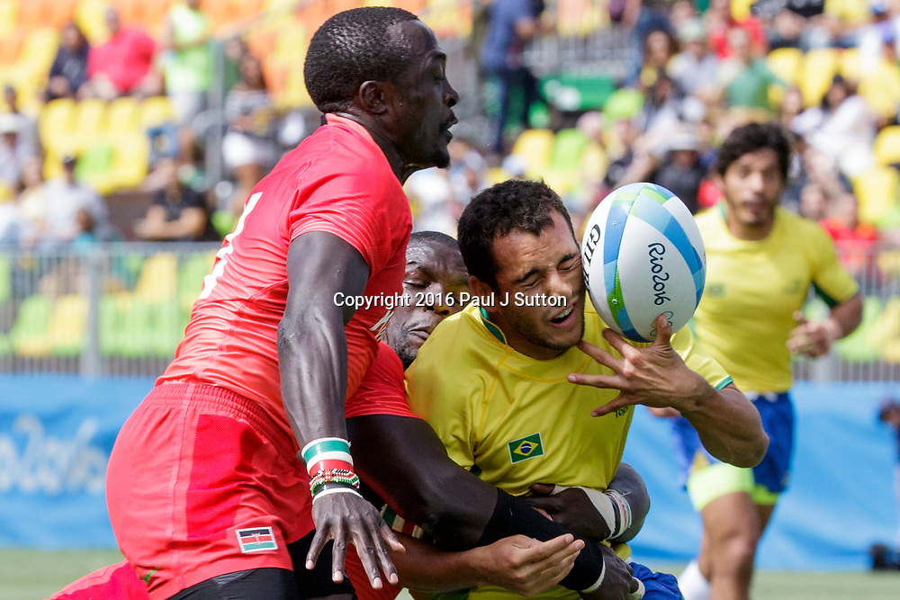 Rio de Janeiro, Brazil. 11 August 2016 Laurent Couhet (BRA), Andrew Amonde (KEN)-C and Collins Injera (KEN) competes in the Men's  Rugby Sevens in a match vs. USA at the 2016 Olympic Summer Games. ©Paul J. Sutton/PCN Photography.