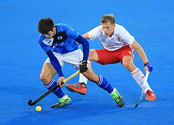 England's Ollie Willars (right) and Korea's Weonki Hwang battle for the ball during the Men's World Hockey League match at Lee Valley Hockey Centre, London.