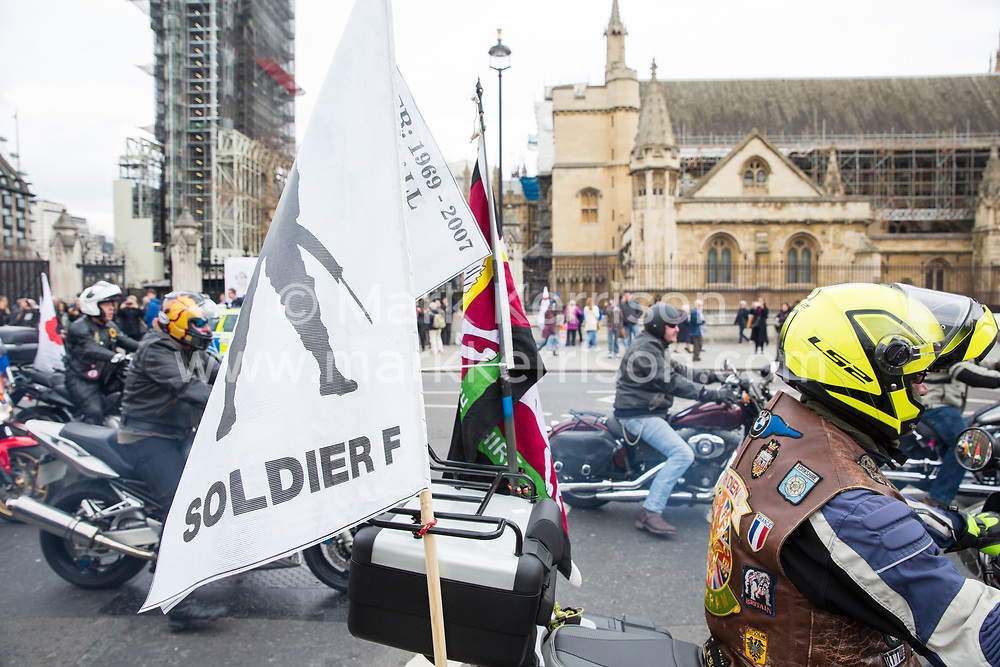 London, UK. 12th April 2019. Thousands of bikers pass the Houses of Parliament as they attend the Rolling Thunder Ride for Soldier F organised by Harry Wragg and other armed forces veterans in support of the 77-year-old former soldier known as Soldier F who is to be prosecuted for the murders of James Wray and William McKinney at a civil rights march in Londonderry on Bloody Sunday in 1972.