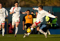 Photo: Leigh Quinnell.<br /> Milton Keynes Dons v Barnet. Coca Cola League 2. 20/01/2007. Barnets Dean Sinclair comes under presure from MK Dons Jon-Paul McGovern.