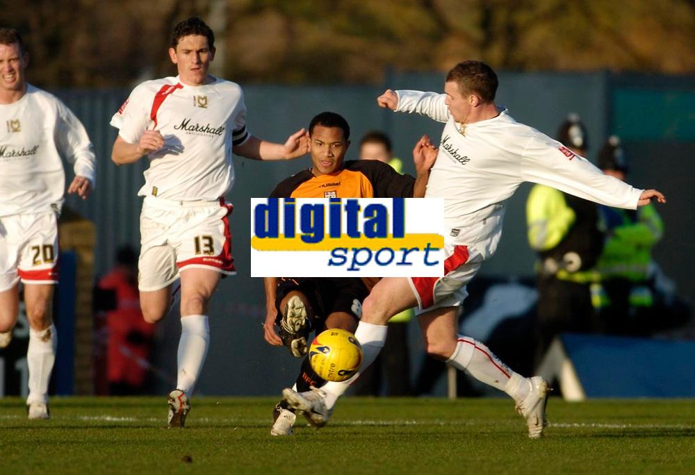 Photo: Leigh Quinnell.<br /> Milton Keynes Dons v Barnet. Coca Cola League 2. 20/01/2007. Barnets Dean Sinclair comes under presure from MK Dons Jon-Paul McGovern.