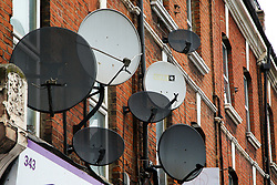 © Licensed to London News Pictures. 07/10/2021. London, UK. Satellite dishes outside buildings in north London. Sky launches a new 'Sky Glass TV' that doesn't need a satellite dish. The new TV will work with WIFI rather than via satellite dish. Photo credit: Dinendra Haria/LNP