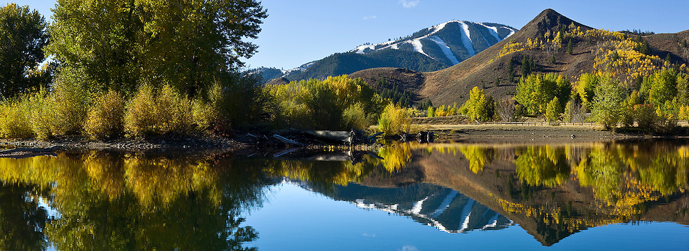 Still autumn morning north of Sun Valley-Ketchum Idaho with reflection in pond off Wood River in Central Idaho