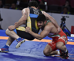Jakarta, Aug. 19, 2018  Alireza Karimimachiani (R) of Iran competes during Men's Wrestling Freestyle 97 kg Final against Magomed Musaev of Kyrgyzstan at the 18th Asian Games at Jakarta, Indonesia, Aug. 19, 2018. (Credit Image: © Lihe/Xinhua via ZUMA Wire)