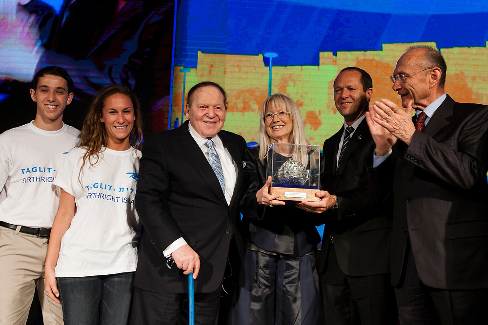 Chief Executive of Las Vegas Sands Corporation Sheldon Adelson (3rd L) and his wife Miriam (3rd R), accept an honorary award for Adelson's efforts to change the face of tourism around the world from Mayor of Jerusalem Nir Barkat (2nd R) and from Israeli Minister of Tourism Uzi Landau (R), during the second Jerusalem International Tourism Summit 2013, held in Jerusalem Israel, on May 28, 2013.