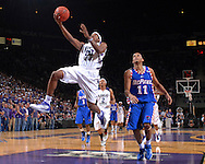 Kansas State forward Cartier Martin (20) races to the basket past Depaul guard Sammy Mejia (11), during second half action at Bramlage Coliseum in Manhattan, Kansas, March 19, 2007.  DePaul defeated Kansas State in the second round of the NIT 70-65.
