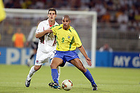 FOOTBALL - CONFEDERATIONS CUP 2003 - GROUP B - BRASIL v USA - 030621 - ADRIANO (BRA) / CARLOS BOCANEGRA (USA) - PHOTO JEAN MARIE HERVIO / DIGITALSPORT
