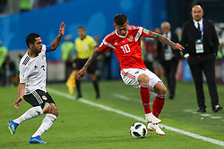 June 19, 2018 - Saint Petersburg, Russia - Fedor Smolov (R) of the Russia national football team vie for the ball during the 2018 FIFA World Cup match, first stage - Group A between Russia and Egypt at Saint Petersburg Stadium on June 19, 2018 in St. Petersburg, Russia. (Credit Image: © Igor Russak/NurPhoto via ZUMA Press)