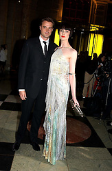 Model ERIN O'CONNOR and JAMIE THEAKSTON at the 2004 British Fashion Awards held at Thhe V&A museum, London on 2nd November 2004.<br />