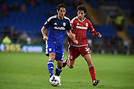 Peter Whittingham  of Cardiff city (l) goes past Diego Fabbrini of Middlesbrough .Skybet football league championship match, Cardiff city v Middlesbrough at the Cardiff city Stadium in Cardiff, South Wales  on Tuesday 20th October 2015.<br /> pic by  Andrew Orchard, Andrew Orchard sports photography.