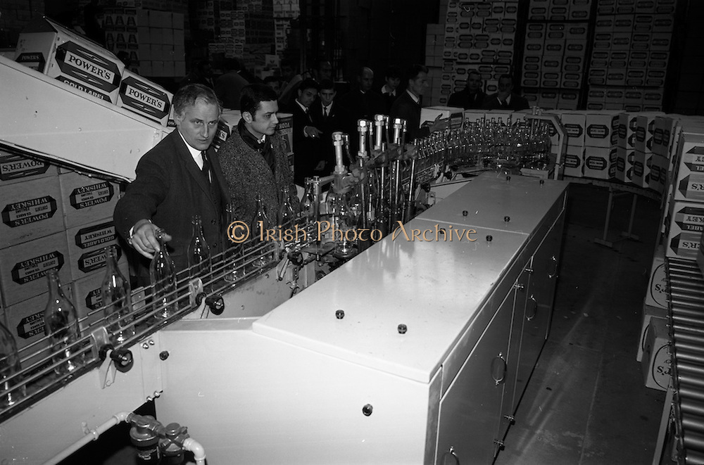 10/02/1967<br /> 02/10/1967<br /> 10 February 1967<br /> Members of French Bartenders Guild and journalists tour John Power and Son Ltd. distillery and bottling facilities at Johns Lane, Dublin.