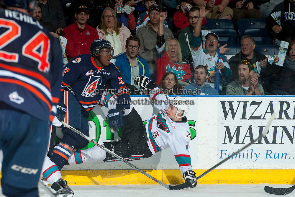 KELOWNA, CANADA - MARCH 26: Jermaine Loewen #32 of Kamloops Blazers is checked by Jordan Borstmayer #11 of Kelowna Rockets on March 26, 2016 at Prospera Place in Kelowna, British Columbia, Canada.  (Photo by Marissa Baecker/Shoot the Breeze)  *** Local Caption *** Jermaine Loewen; Jordan Borstmayer;