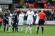 Swansea city's Michu has words with referee Anthony Taylor after he collides with Tottenham's Scott Parker . Barclays Premier League, Swansea city v Tottenham Hotspur at the Liberty Stadium in Swansea, South Wales on Saturday 30th March 2013. pic by Andrew Orchard, Andrew Orchard sports photography,