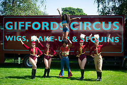 """Giffords Circus presents """"Xanadu"""" <br /> Produced by Nell Gifford  - Directed by Cal McCrystal<br /> At Chisiwck House and Park, London, Great Britain <br /> Press view <br /> 27th June 2019 <br /> <br /> Performers pose for pictures infront of one of the Giffords trucks <br /> <br /> Roll up, roll in to the stately pleasure-dome for miracles, song, symphony and enchantment. Musicians, horses, clowns and tumblers enfolded in this joyful paradise, with music loud and long - the Giffords Circus caravan will be taking to the road for a 2019 summer of love.<br /> <br /> <br /> It is midsummer 1973 in Hyde Park and the flower power movement is at its height. Hippies, hipsters, rock stars, musicians, wild women and global nomads with Shamanic horses gather to play, sing, dance, protest and perform. Policemen and a family of out-of-towners get caught up in the celebrations. Will they get in the groove? Nell Gifford builds a pleasure dome and Tweedy has a job in the kitchen as he thought everyone was talking about """"Flour Power"""". As evening approaches, the ever more chaotic event careers towards a joyful, transcendental finale. <br /> <br /> Photograph by Elliott Franks"""