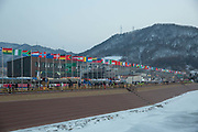 International flags opposite the Pyeongchang Olympic Stadium ahead of the opening ceremony for the 2018 Winter Olympic Games on 9th February 2018 in Pyeongchang, South Korea