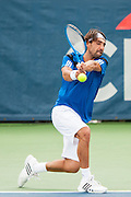 Cypress' Marcos Baghdatis hits a return to USA's John Isner during their men's quarterfinals singles match at the Citi Open ATP tennis tournament in Washington, DC, USA, 2 Aug 2013. Isner won the match 6-7, 6-4, 6-4 to advance to the semifinals on Saturday.