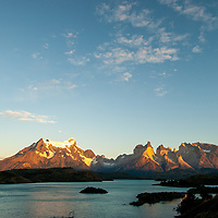 The Grand Tower of Paine (L) and Horns of Paine tower above Lake Pehoe in Torres del Paine National Park, Chile.