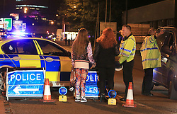 Police at Manchester Arena after reports of an explosion at the venue during an Ariana Grande gig.