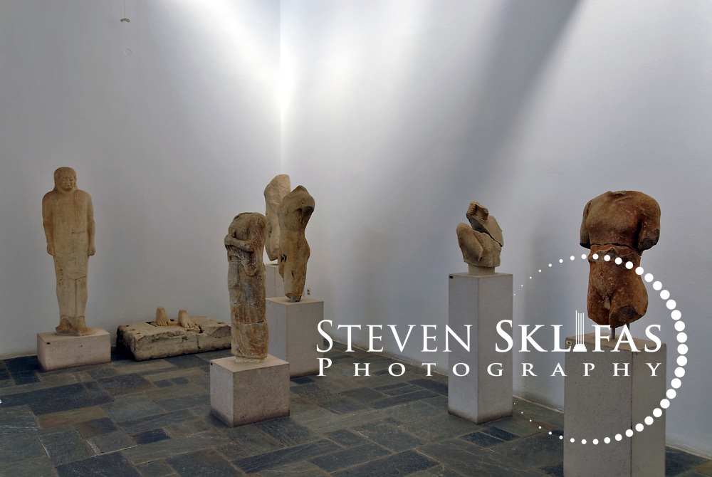 Greece. Samos. Archaic statues sculptures from the 6th century BC at the Archaeological Museum in Vathy or Samos town. The statue on the far left of the image is the figure of the dressed youth which is particularly rare in the Archaic art of Attica, although not uncommon in Ionia. Dating from 540 BC, the youth has oriental features and short neck which relates more to art of Ionia.