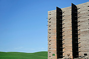 The ruins of a wooden grain elevator overlook the rolling hills of the Palouse region of Eastern Washington.