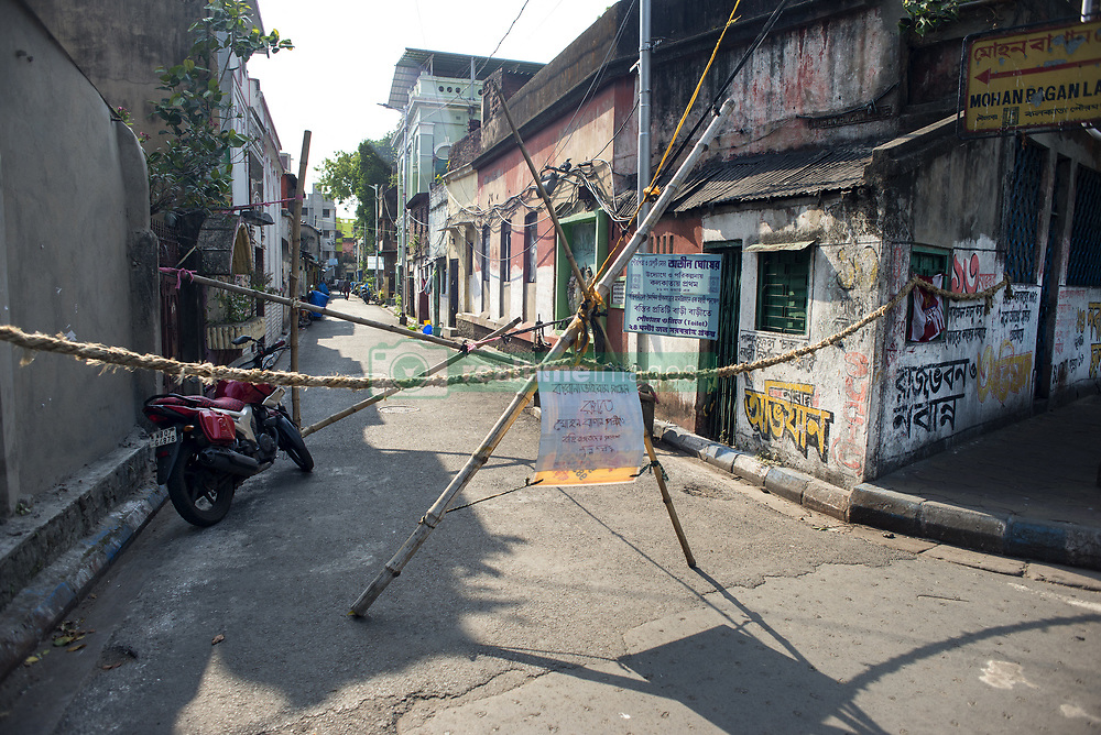 A neighbourhood in Kolkata is cordoned off by the residents to stay isolated from the rest of the city. Corona virus is spreading at a high rate in Kolkata being one of the red zones in the country. According to central government no body can enter or exit the red zone except emergency workers. The localities with major outbreaks of the disease has been marked as red zone or hot spot. The central government's strategy to contain the coronavirus in the second phase of the lockdown includes dividing the districts based on the number of coronavirus cases. As per the orders, 170 districts of India's 720 districts have been declared as 'Red Zones' also known as hotspot areas. Kolkata, West Bengal, India, April 19, 2020. Photo by Arindam Mukherjee/ABACAPRESS.COM