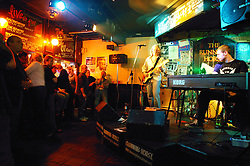Band playing to audience in a pub,