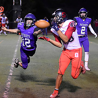 Photo: Jeffery Jones:<br /> Grants Pirate wide receiver Adrian Ortega (40) catches a touchdwn pass Friday while Miyamura Patriot LanceEvans (12) reaches to try to break up the pass at Angelo DiPaulo Memorial Stadium in Gallup.